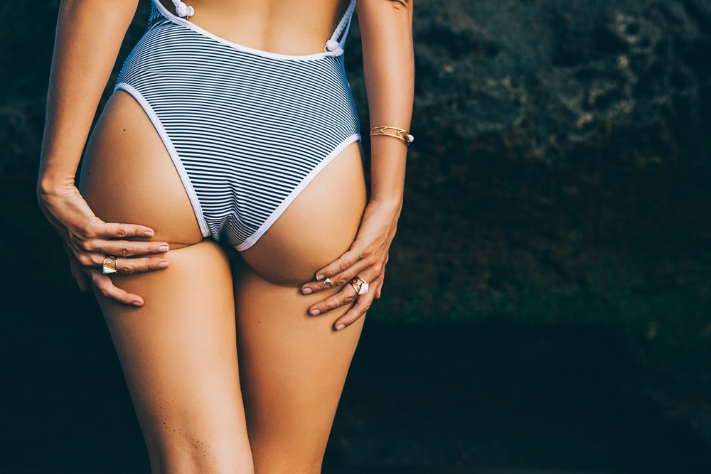 Close up of a woman in a swimsuit and her butt